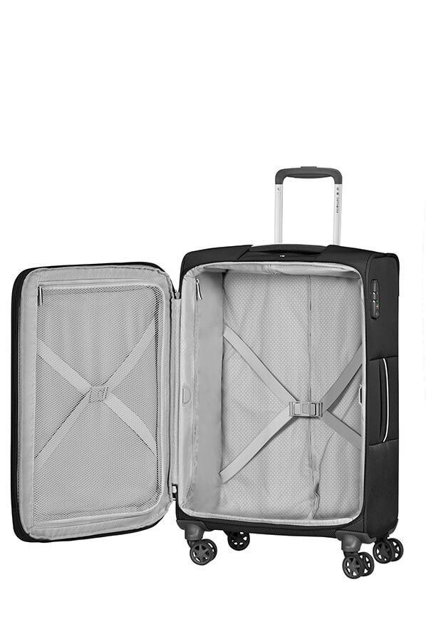 Bagaż posiada wewnątrz dużą komore do pakowania, dwa pajączki do przytrzymania ubrań oraz przode zamykana na suwakegr