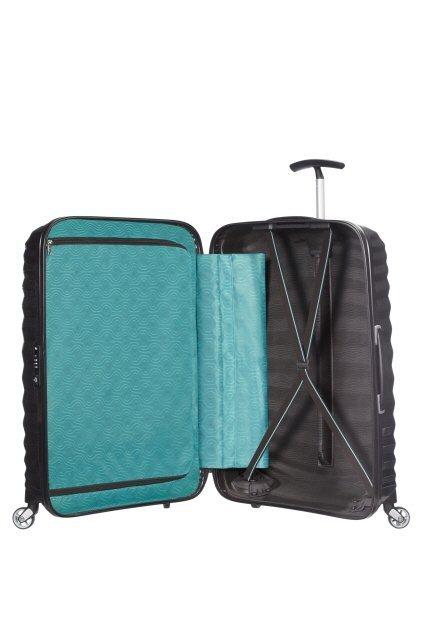 Bagaż wewnątrz po jednej stronie posiada materiałową przekładkę zapinaną suwak, a po drugiej stronie pas spinający ubrania