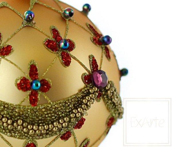 szklana bombka złota w czerwone kwiaty