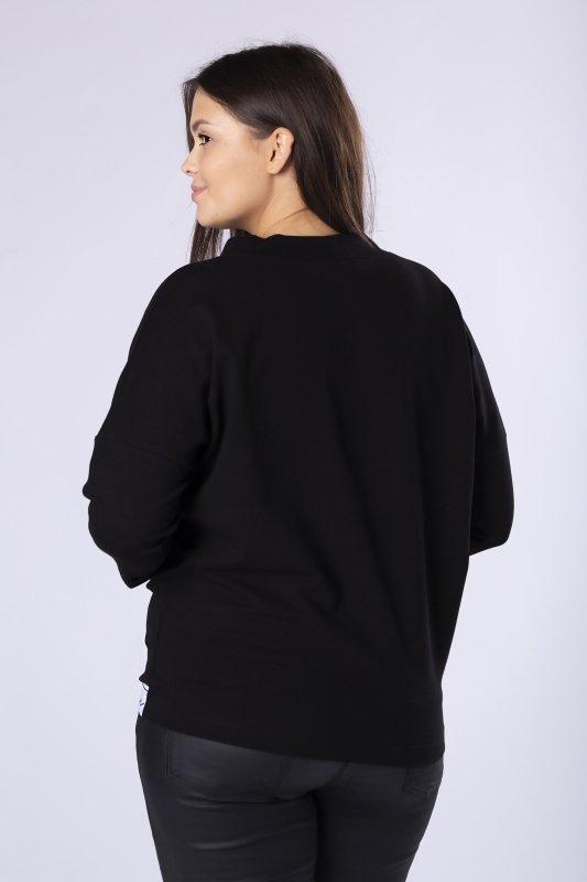 dzianinowa bluzka z kieszenią na biuście i ozdobną lamówką na dole