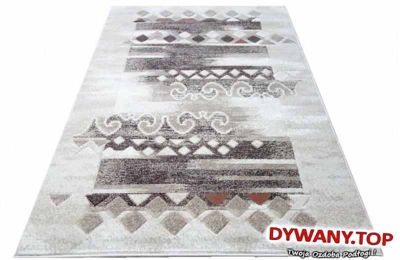 Wzór imitujący podniszczony dywan