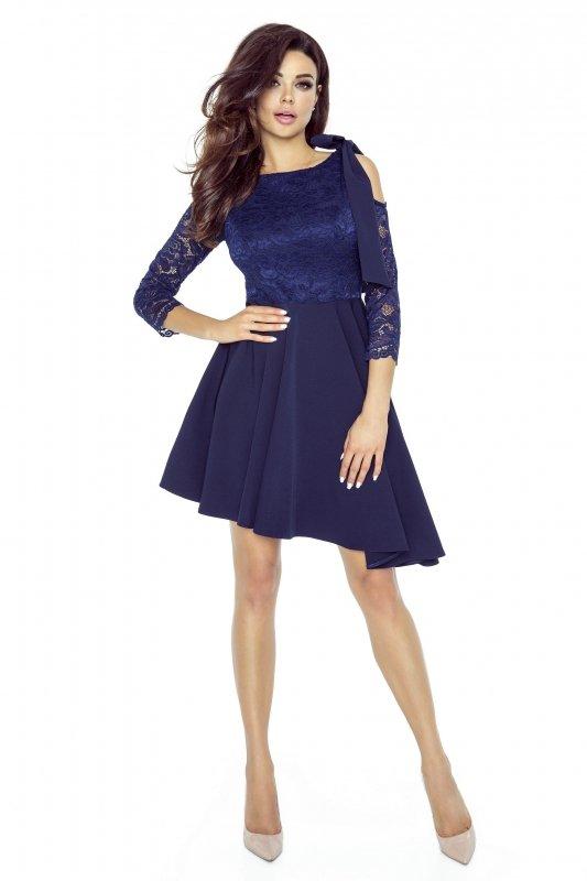 Koronkowa sukienka z asymetrycznym dołem