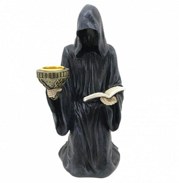 Kazanie Ostateczne - świecznik z mroczną postacią