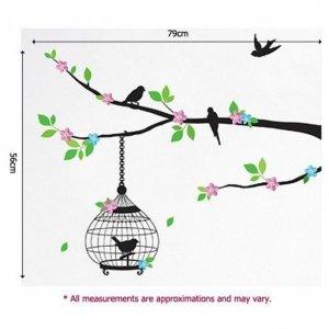 Gałązka drzewa z ptaszkami i klatką