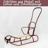 Schlitten aus Metall mit Rückenlehne und Schiebestange in weinrot
