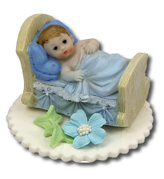 Bobas w łóżeczku niebieski - dekoracja tortu na chrzest
