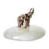 Figurka na szczęście, mały metalowy słoń na szklanym postumencie.